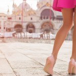 Elegant lady with beautiful legs in high heel shoes in Venice